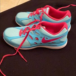 Pink and turquoise Nike running shoes brand new